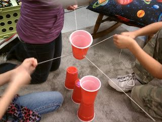 Setting Expectations for Group Work: Fun activity to introduce working in groups (team work). Build a pyramid using plastic cups, a rubberband, and four pieces of string. Cannot touch the cups with your hands.  Science Gal