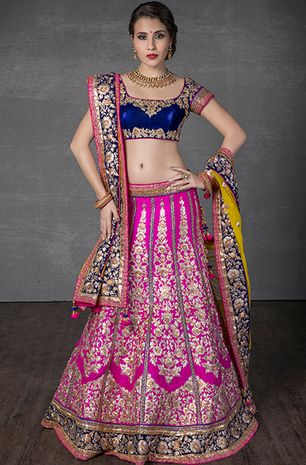Rawsilk ghagra with net dupatta and velvet blouse embellished with zari and stone work