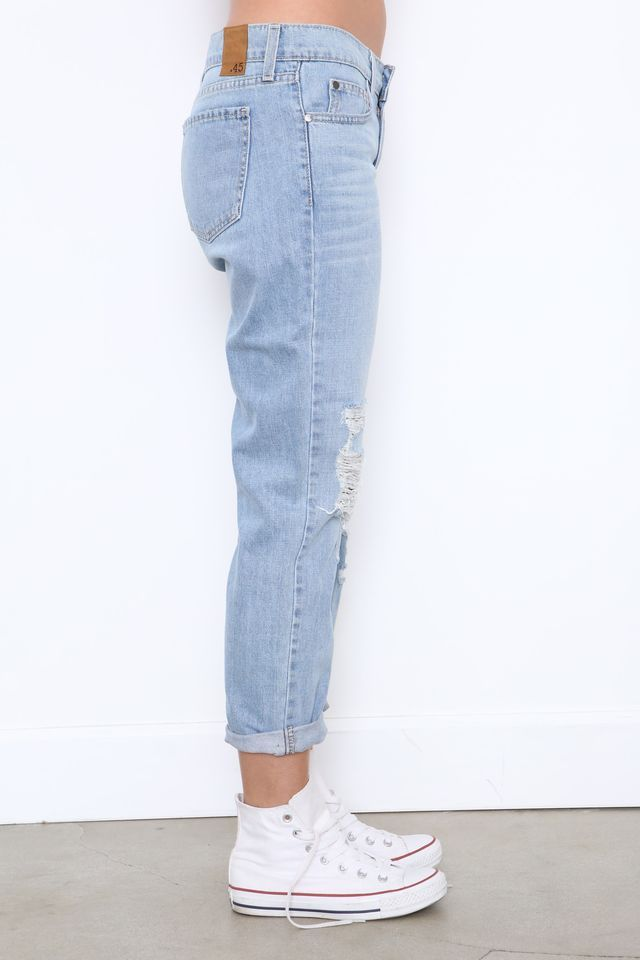 Faded and distressed boyfriend jean. Five pocket construction. Front button  and zipper fly closures. Style Material: Cotton Color: