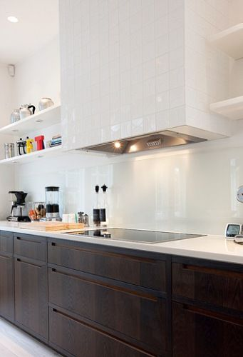 Cabinets / back-splash / tiled hood / shelves. Very pretty.