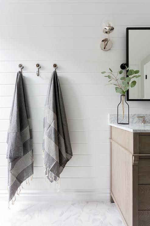 Mounted To A White Tongue And Groove Wall Vintage Towel Hooks Are Fitted Over Marble Like He Tongue And Groove Walls White Bathroom Interior Bathroom Interior