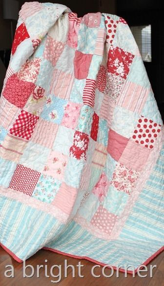 red pink aqua   - love the softness of the colors and the mitered striped borders of this quilt