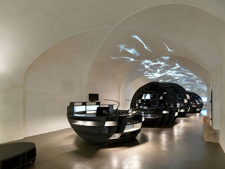 Designer: INNOCAD Architektur. Project: Graz Tourismus information center. Location: Graz, Austria. Photography by Paul Ott.