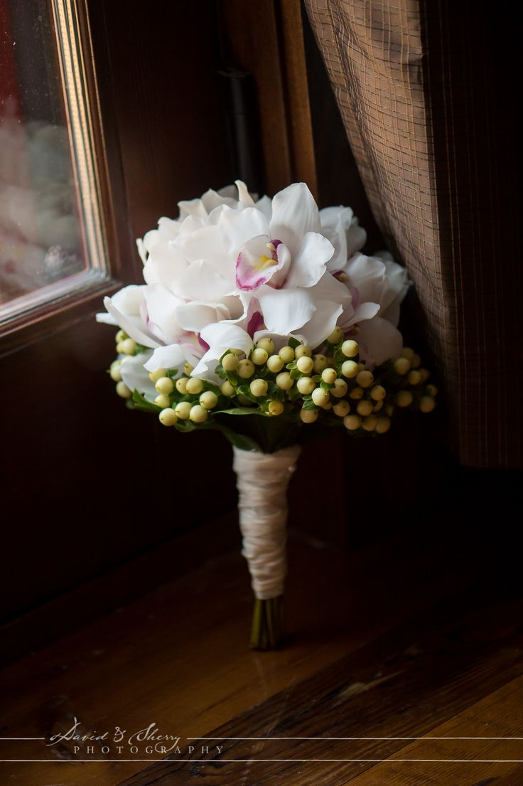 White cymbidium Orchids in a wedding bouquet