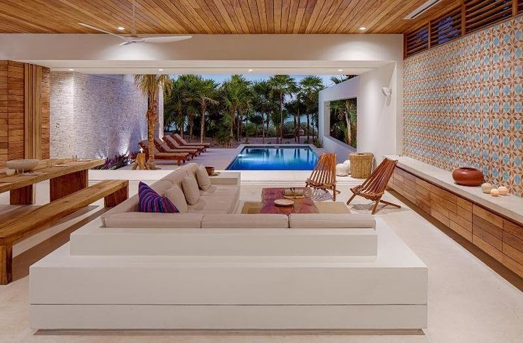 Modern home with Living Room, Chair, Sofa, Ceiling Lighting, Coffee Tables, and Recessed Lighting. Photo 2 of Casa Xixim