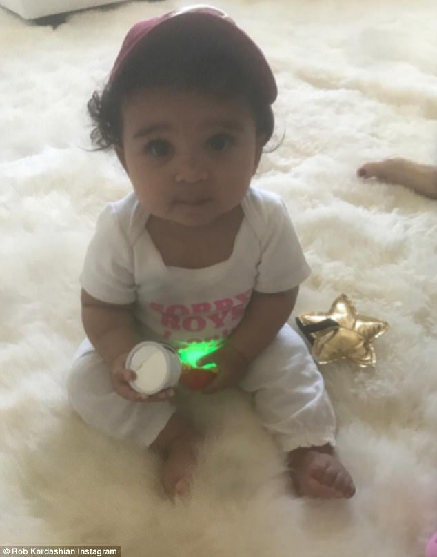 'She is sitting up on her own': Proud dad Rob Kardashian, 30, gushed about his seven-month-old daughter Dream as he shared a cute picture on Instagram on Friday