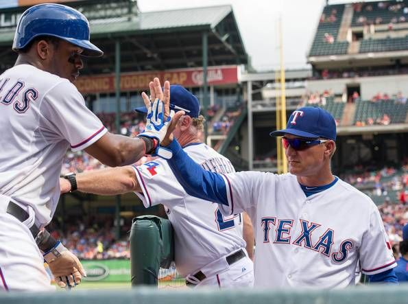 Jun 13, 2015; Arlington, TX, USA; Texas Rangers manager Jeff Banister (28) congratulates catcher Robinson Chirinos (61) after Chirinos scores during the fifth inning against the Minnesota Twins at Globe Life Park in Arlington. Mandatory Credit: Jerome Miron-USA TODAY Sports #Texas #Rangers #TexasRangers #MLB #Baseball #NeverEverQuit
