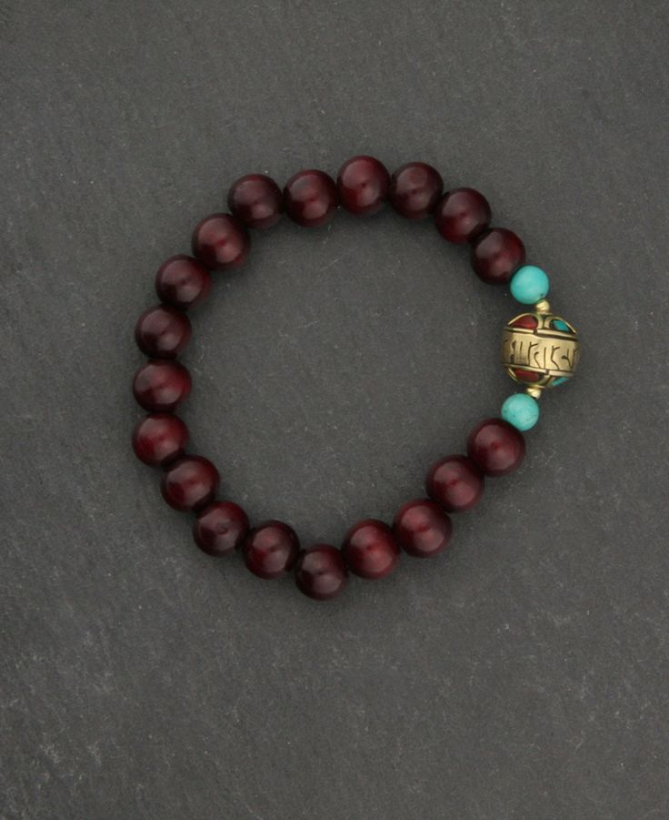 Rosewood bracelet with brass Om Mani Padme Hum Mantra. Buddhist bracelets and meditation supplies available at BuddhaGroove.com.