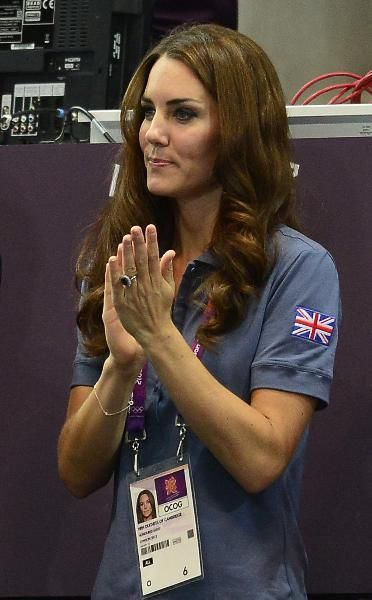 The Kate Middleton Olympic Fashion Parade In a Team GB shirt, Catherine, Duchess of Cambridge applauds Britain's handball team at the end of the women's preliminary Group A handball match Croatia vs Great Brit