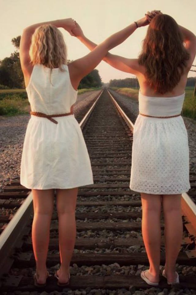 Best friend pictures infinity sign in the train tracks @Hannah Lochala