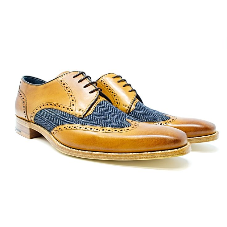 A wingtip derby with punched detail constructed using contrasting material options. 7mm Leather Sole Goodyear Welted Shoe Style Derby, Wingtip Last Shape: 443 F