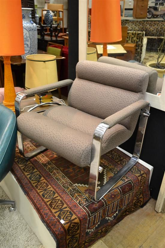 AN EERO AARNIO CHROME AND UPHOLSTERED CHAIR MANUFACTURED BY FRAMAC $100