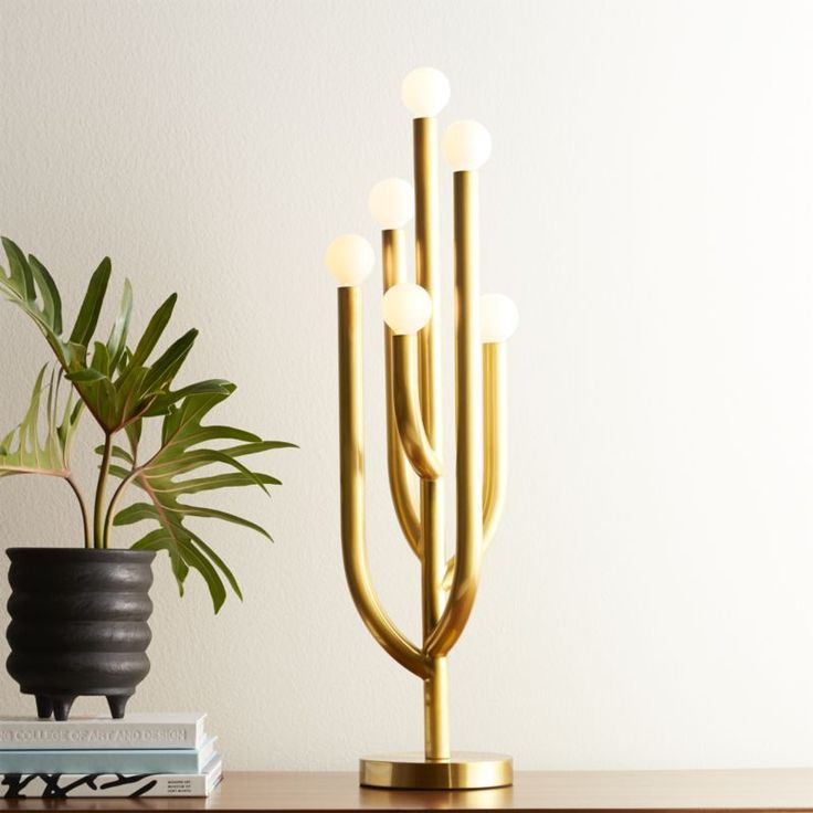 Shop Cacti Glow Brass Table Lamp.   Cactus blooms to life as a modern brass table lamp with vintage vibes.  Borrowed from Fred Segal's design archives, we love its organic yet sculptural lines.  CB2 exclusive.