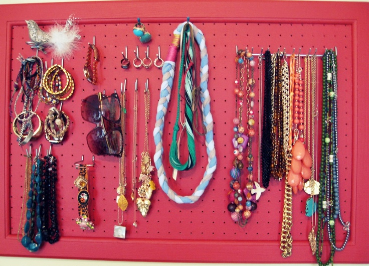 This is the best idea ever. Paint a peg board and use the hooks to display/organize your jewelry.