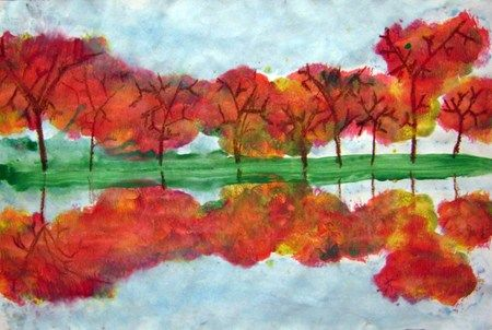 In this project, students learned a new way to draw trees--the Y method. Then they painted leaves, sky, and land and used a monoprinting technique to make a reflection.
