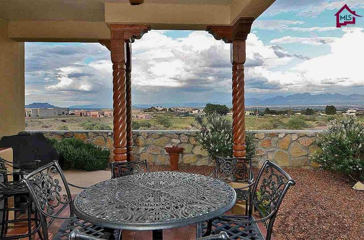 Southwestern Porch with Bird bath, Fence, exterior tile floors, Outdoor kitchen