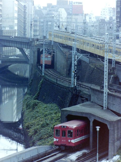 This is an iconic view of Ochanomizu (御茶ノ水) station in Tokyo, looking towards Akihabara, where occasionally you can see trains from the Marunouchi Subway line (bottom left), Chuo Rapid (middle) and Sobu Local (top) crossing each other at the same time.