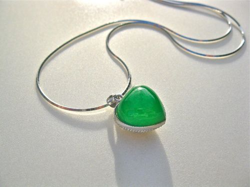 Green jade + silver heart necklace. Beautiful green jade heart necklace - believed to attract love This Jade heart necklace is really special: It features a deep-green jade and sterling-silver heart hanging on a gorgeous shiny sterling-silver chain. Jade has been treasured in China as a royal gemstone with special properties since at least 3,000 BC . . a great many years! Jade jewellery has deep significance.