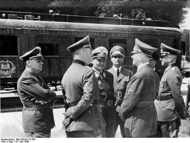 L to R: Joachim von Ribbentrop, Wilhelm Keitel, Hermann Göring, Rudolf Heß, Adolf Hitler, and Walther von Brauchitsch before the railroad car that hosted the French surrender, Compiègne, France, 22 Jun 1940. (German Federal Archive: Bild 183-M1112-500)