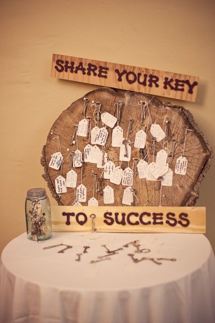 Guest Book: we used a large tree stump, nailed a ton of long nails into it, added a jar full of skeleton keys with tags attached and asked the guests to scribble their keys to a successful marraige on the tag and hang them on the tree stump. Now Stacy and Kevin have an amazing art piece in their home that will give them wisdom and remind them of their favorite day. diy