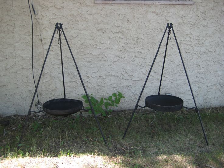 A couple tripod braziers