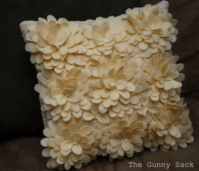 """Knockoff pillow from layered felt flowers. Good tutorial with """"pattern"""" and clear instructions."""
