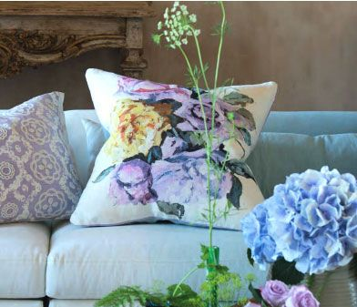 Designers Guild Viola Heather Floral Throw Pillow  $195.00  A rich and vivacious digitally printed floral cushion. feminine impressionistic arrangements in soft pastel shades, upon a soft white linen ground. fine heather silk trim on all sides, and pale celadon reverse.  Size: 60 x 60 cm Available in store at Putti Toronto Canada and online at www.putti.ca