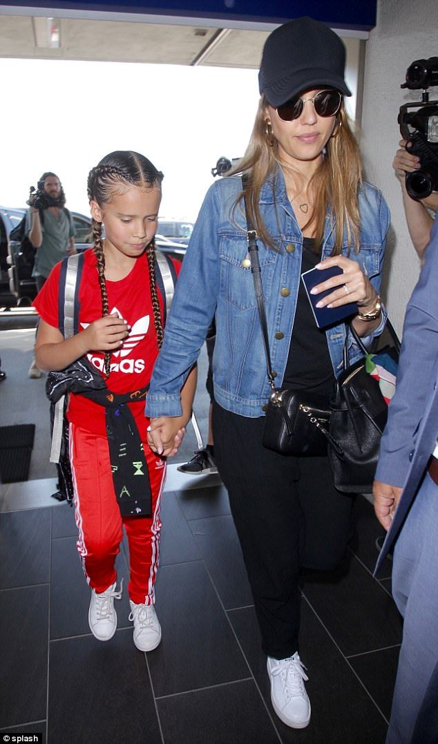Mini-me: Her adorable daughter Honor sported a bright red Adidas tracksuit that was age appropriate with white sneakers