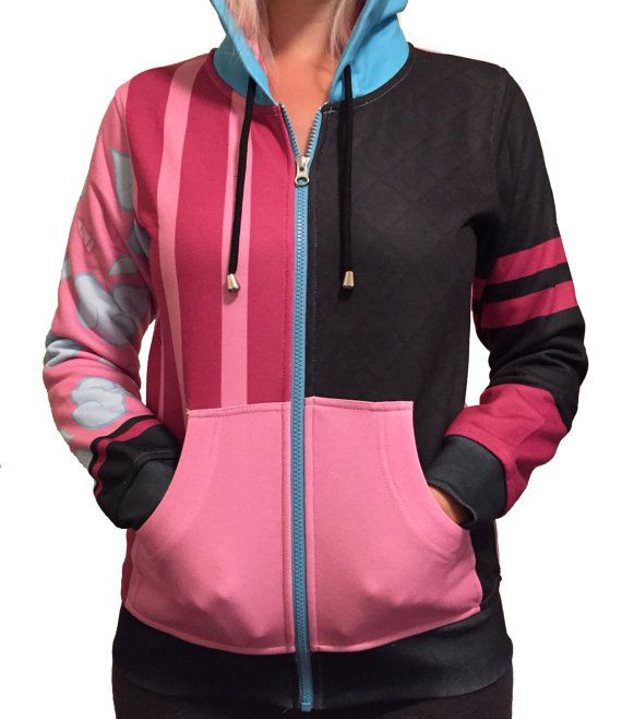 Custom hoodie inspired by Jinx from League of Legends. Made of 100% polyester.  The model is wearing a Womens Size Medium and is 58 and 135 lbs.