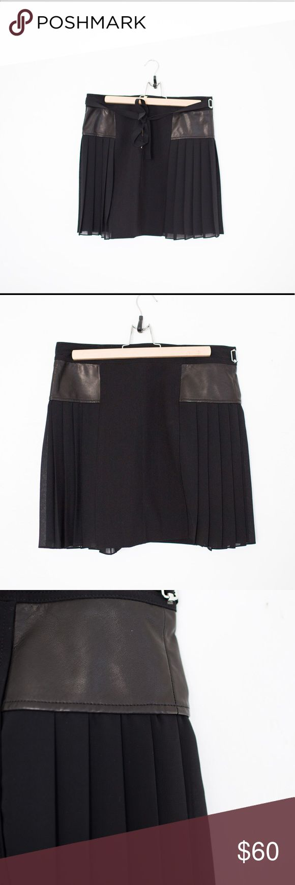 Black Rebecca Taylor leather panel pleated skirt Black Rebecca Taylor skirt with leather side panels and pleats. Back features a gold zipper. ties in the back. Size 8 *first two photos are stock photos and may not be the same size skirt Rebecca Taylor Skirts Mini
