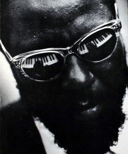 """Thelonious Monk (1917-1982),  """"was American jazz pianist and composer considered one of the giants of American music.[He] had a unique improvisational style and made numerous contributions to the standard jazz repertoire""""  Source:  Wikipedia"""
