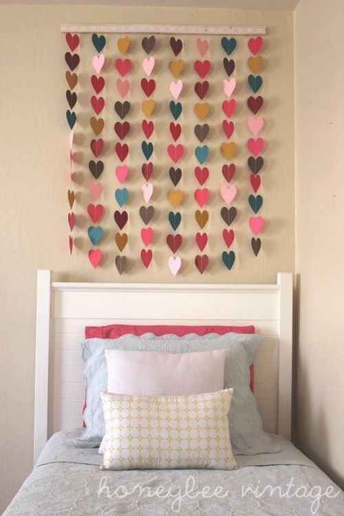"DIY Paper Heart Wall Art:    Make heart template from posterboard. Trace and cut 88 hearts. Divide into 8 secitons of 11. Sew each strand together, leaving a 1"" gap between each heart and long threads at the top of each row to wrap around the wood or punch holes in wood and tie. Decorate or glue fabric to cover wood. With anchors."