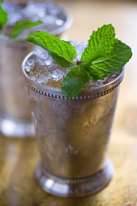 Mint Julep. 'A mint julep is traditionally made with four ingredients: mint leaf, bourbon, sugar, and water. Traditionally, spearmint is the mint of choice used in Southern states, and in Kentucky in particular.' http://www.lonelyplanet.com/usa