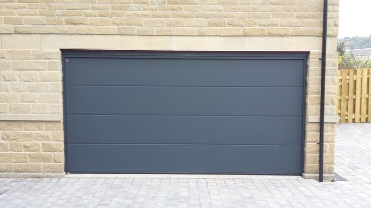 Hormann LPU40 L Ribbed Sectional Door By ABi Hormann LPU40 L Ribbed insulated sectional garage door in Anthracite Grey Installed in Huddersfield: http://abigaragedoors.co.uk/garage-doors-huddersfield.