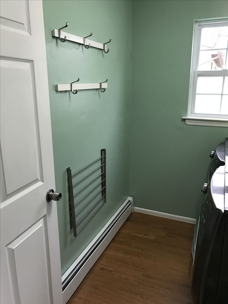 My Laundry room reno reveal, paint color is valspar tranquil bay, hooks and rail from target, clothes rack from Ikea