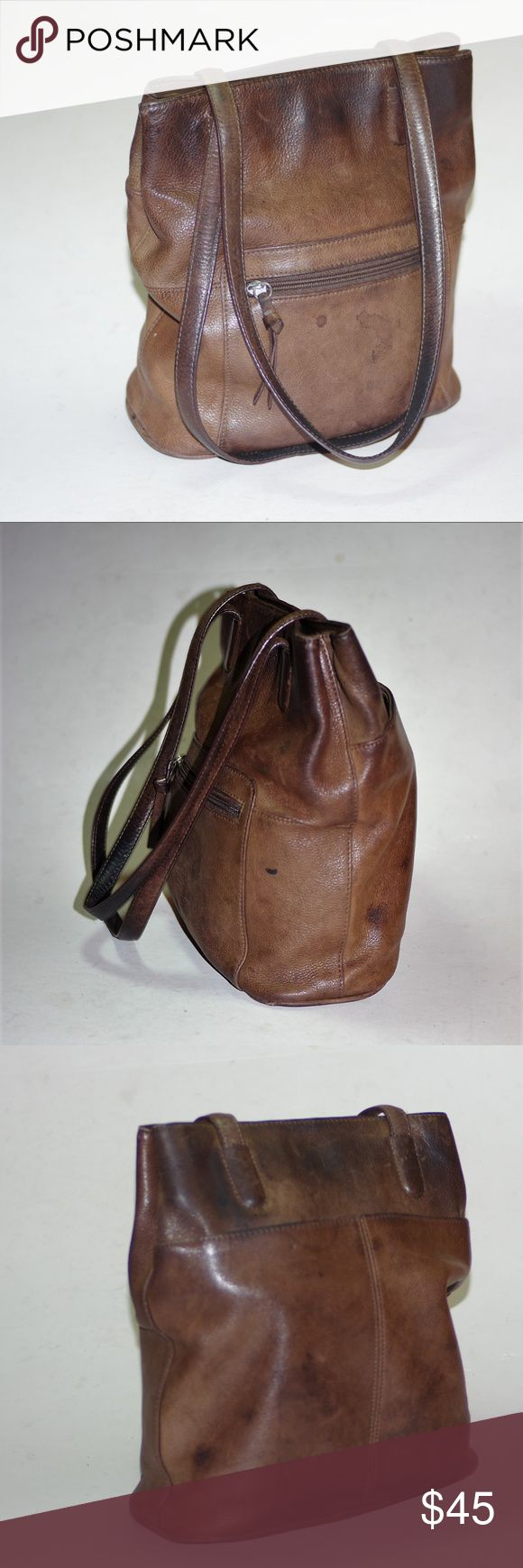 """Leather Purse Bag Hobo Bucket Wilsons Vintage Nice Leather Purse Bag Hobo Bucket Wilsons Vintage Nice By Wilson's Leather Brown Distrssed Look Leather Bag Bucket Hobo Style This bag is deep with main compartments divided by zip pocket which is deep too! zip pull missing on center pocket Zip pocket in liner for coins or 'smalls"""" Satchel Style handles rise 11"""" from top of bag Measures:  9x4.5x10.5 Super bag Has a couple outer blemishes consistent for age unworn Wilsons Leather Bags Hobos"""