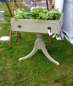 Repurposed  old drawer and pedestal stand becomes a planter.  Wouldn't last forever outdoors but on a covered patio and with a liner, could work!  Recycle, repurpose, upcycle, salvage, diy!  For ideas and goods shop at Estate ReSale & ReDesign, Bonita Springs, FL