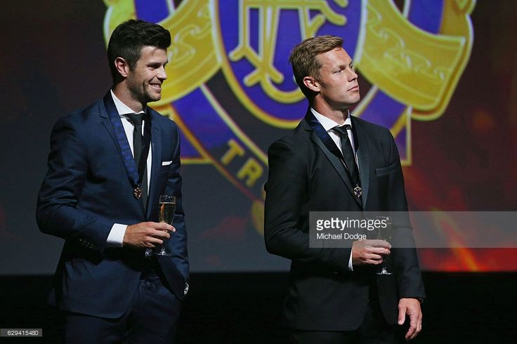 Sam Mitchell (R) of the West Coast Eagles (formerly of the Hawthorn Hawks) and Trent Cotchin of the Richmond Tigers raise their glasses with their Brownlow Medals during the 2012 Brownlow Medal presentation on December 13, 2016 in Melbourne, Australia.