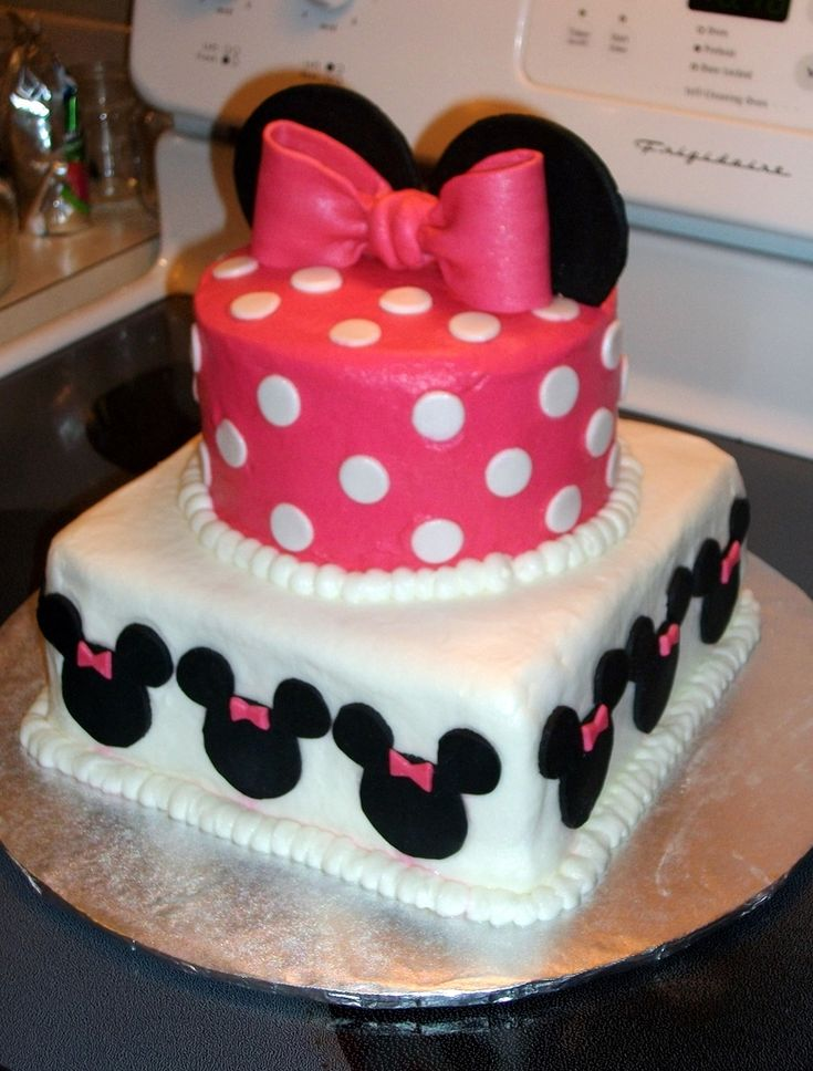 Minnie Mouse Cake - Iced in buttercream with fondant minnie mouse, bow, and ears.