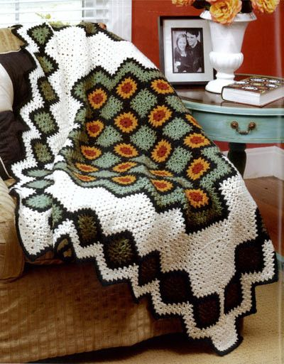 Oooh! Saw this pattern and I think I rediscovered an itch to crochet. It looks like a combo of granny squares and ripple afghan in the round. I like unique!