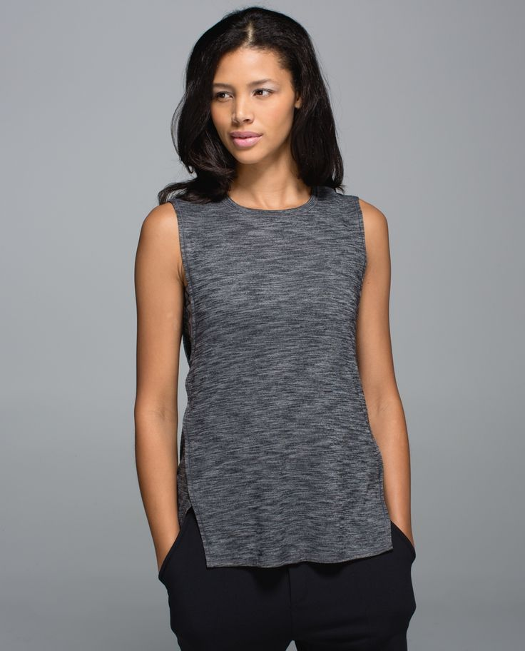 Go play outside! This high coverage tank helps keep rays at bay - and shows off our biceps. Sweat-wicking fabric helps us keep our cool and a high neck, back and armholes keep us covered.