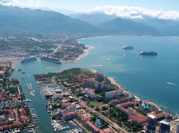 Malecon Puerto Vallarta's Malecon is one of the most popular, and walker friendly, spots in town. The Malecon is a picturesque walkway that sits between downtown Puerto Vallarta and the brilliant b…