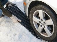 If you're ever caught with a helplessly spinning tire, Traction Mat's linked treads can give needed grip on icy, muddy, or just uneven terrain.     Founder Meghan Edge found herself in a common predicament—in her car, stuck in the snow. She used a flat mat to try to get unstuck, but it wouldn't grip the uneven ground.     Meghan designed Traction Mat with innovative links that make it flexible, so it hugs the ground and won't crack. Unroll Traction Mat under your tire (either the rear or…