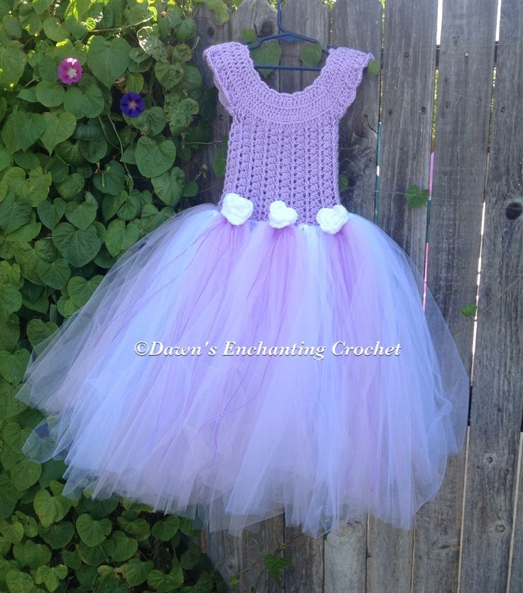 Lavender crocheted tutu dress with white flowers.