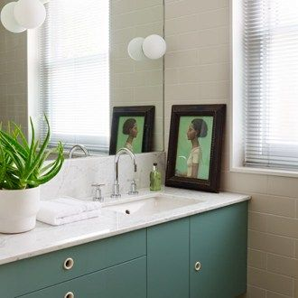 In the bathroom Artemide 'Dioscuri' lights float on the surface of the mirror like bubbles in a bath. The motif is echoed in the handles of the teal cabinets, which were designed by Hugh, providing plenty of much-needed storage in the small space.