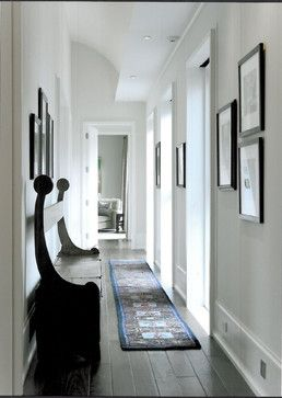 I love this space with the dark floors and white walls.  Classic.