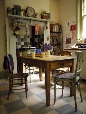Chequered linoleum kitchen floor with table chairs and aga