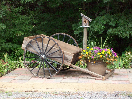 Beautiful Cute Cart.. Garden JunkGarden ArtGarden IdeasFlower CartWagon Wheels WheelbarrowGarden PhotosOutdoor DecorOutdoor Spaces