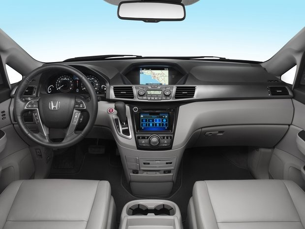 The refreshed 2014 Honda Odyssey Touring Elite comes with an integrated vacuum developed in conjunction with ShopVac. It's the first such feature sold in a vehicle, according to Honda.
