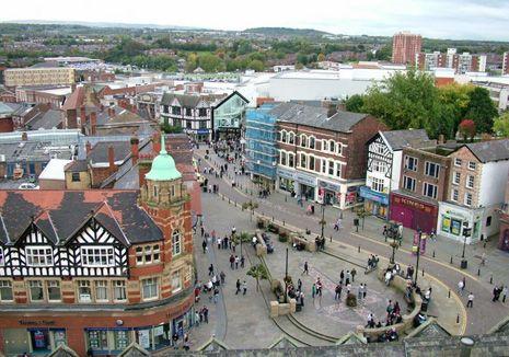 Wigan, west-northwest of Manchester
